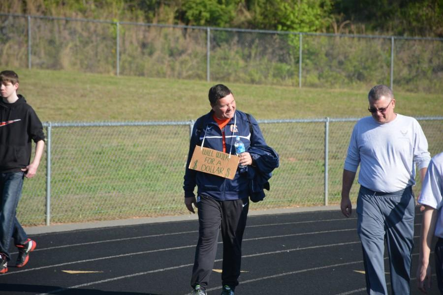Social studies teacher Will Maley walks the track on May 1, 2015. Maley walks for 12 hours each year to raise awareness for cancer, but this will be his last year.