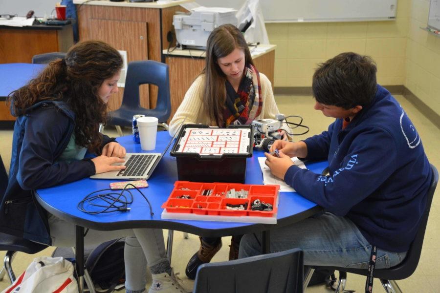 Sophomores Graci Moore, Carly Rae Blackston and Chandler Poteat work on Lego Robotics during physical science.