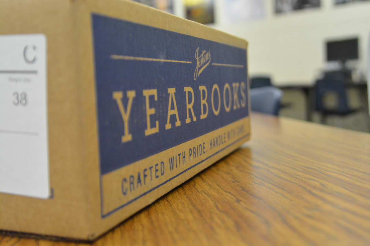 A box of yearbooks sits on a table in Alex Holliss classroom, room 323. Yearbook Day is May 12.