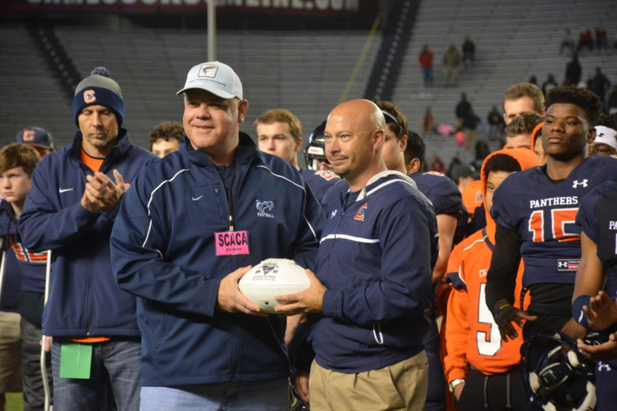 Head Coach Mark Hodge receiving the game ball