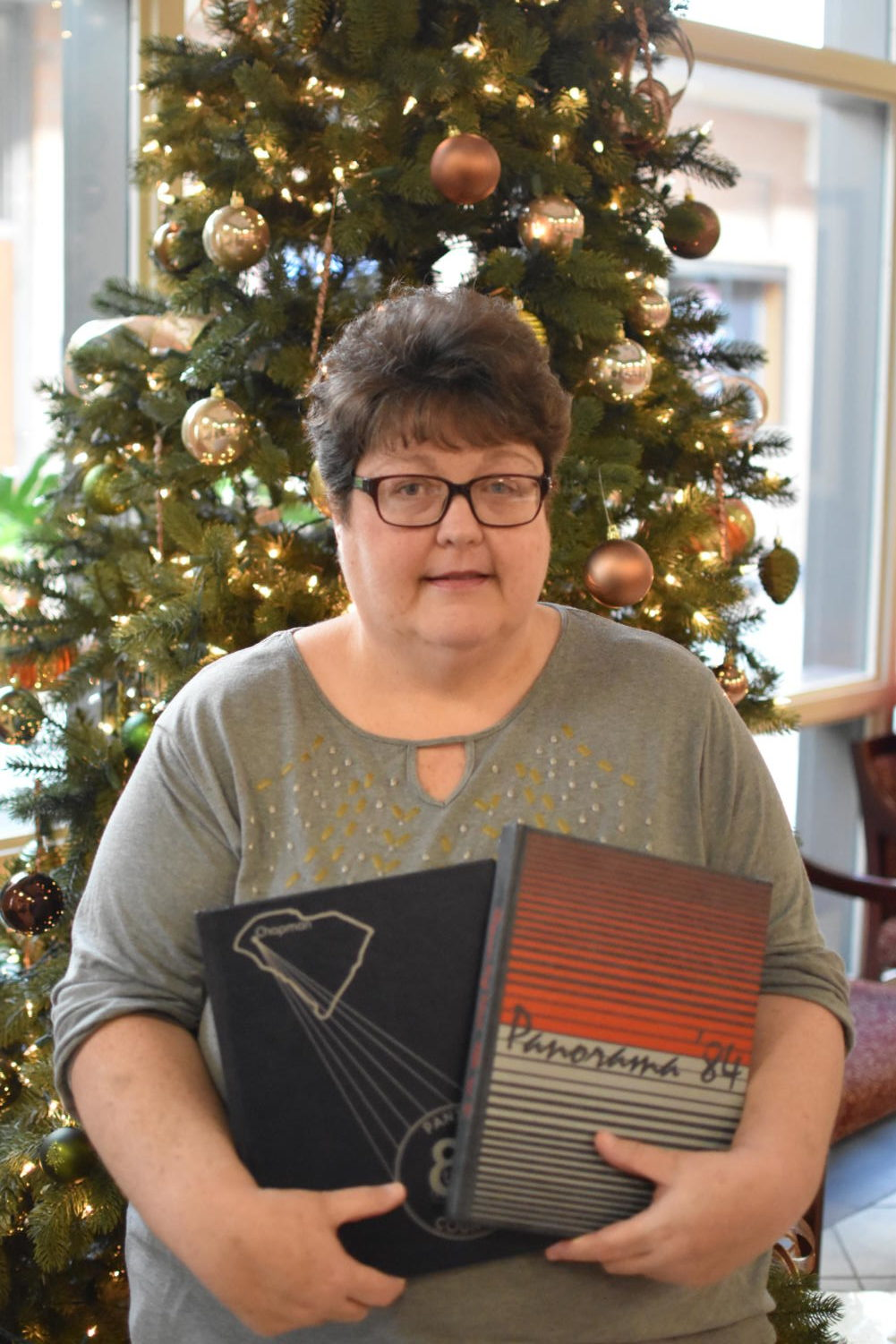 Ms. Myra Jenkins receives copies of her Chapman yearbooks from her days as a student.