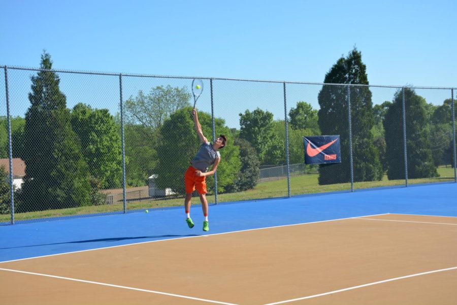 Junior+Zack+Martin+smashes+his+first+serve.