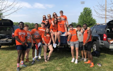 Chapman students decked out in orange at the pregame tailgate ready to cheer on the panthers in a game against Woodruff