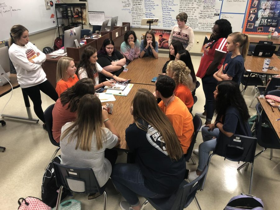 The 2019-2020 Panorama staff meets earlier this year (prior to the extended school closure) to discuss the book.
