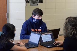 Students work independently in an English course. Each student is wearing a mask as a way to follow Chapman's safety protocol.