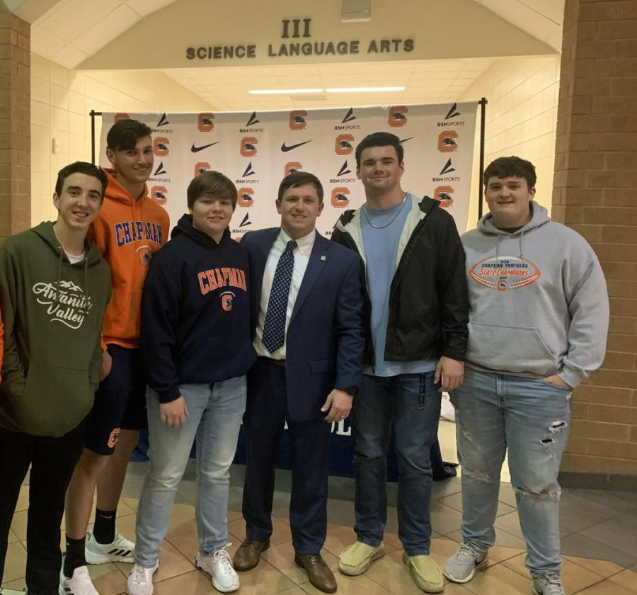 Coach Cabaniss with players at his community introduction last spring.