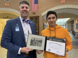 Chapman principal Andrew McMillan and senior Christopher Freire stand together with Freire's West Point certificate of appointment.