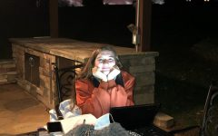 Senior Ansley Hill works on school work during quarantine.