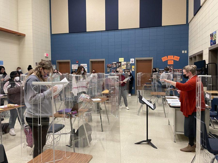 Rebecca Rostron directs her third-block chorus class.