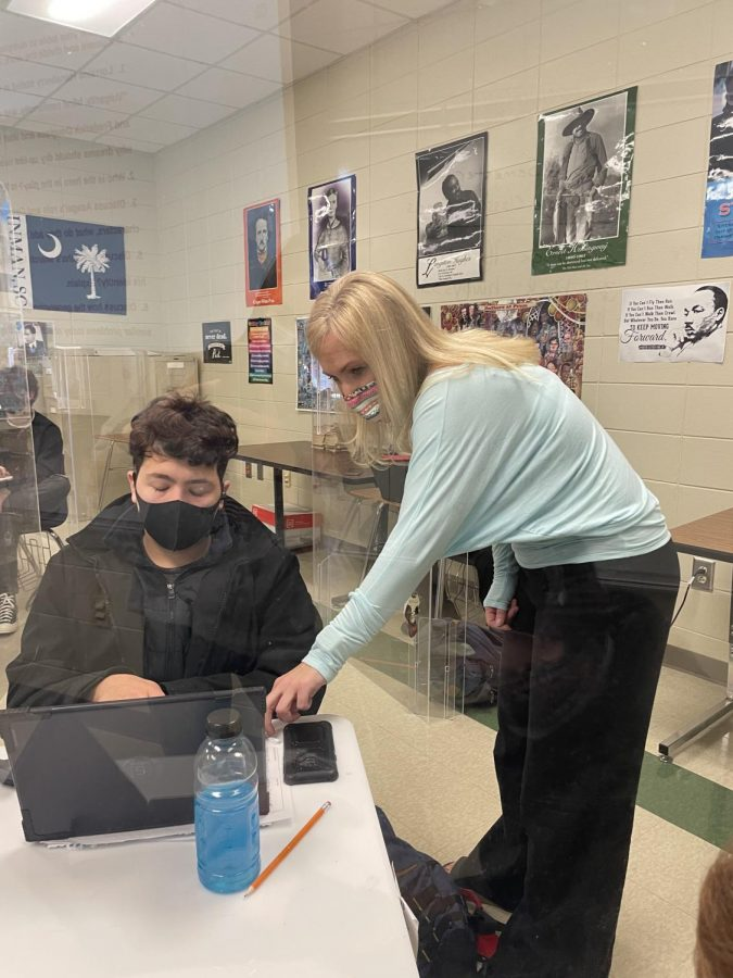 Chapman teacher Molly Blackwell helps a student in English III. Blackwell was named the 2020-2021 Teacher of the Year.