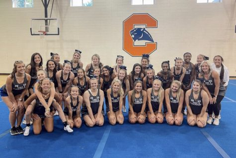 The Chapman High School varsity cheerleading team poses for a picture. The team is being led by new coach Allie Linnerud.