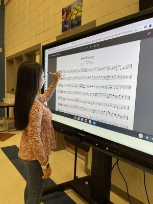 Sophomore Kaia Grace Lawter works on sight reading during choralation.