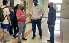 English teachers Erin Smith (left), Andy Lopez and Alex Hollis chat between classes. The strong professional relationships among faculty members have helped Chapman avoid the teacher shortages currently facing the nation.