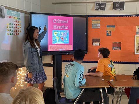Social studies teacher Kimberly Ensley teaches her 4th block Human Geography class. Ensley is a graduate of Chapman.